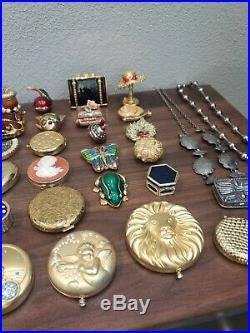Huge lot of Estee Lauder Solid Perfume Compact and book